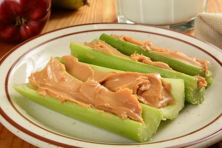 Crispy celery sticks with organic peanut butter and milk