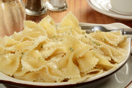 buttered: Buttered farfalle pasta noodles with parmesan cheese Stock Photo