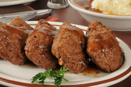 Meatloaf shaped into individual serving loaves on a serving platter photo