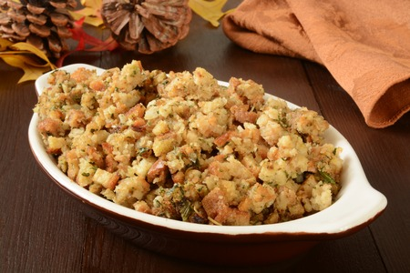 A small casserole dish of herbal holiday stuffing in turkey juice