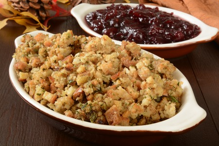 stuffing: Dishes of turkey stuffing and chunky cranberry sauce Stock Photo