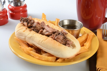 jus: A roast beef sandwich au jus with french fries