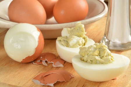 hard boiled: hard boiled eggs and egg salad on a cutting board with salt