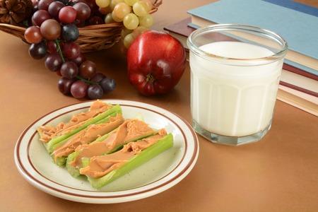 Peanut butter in celery sticks as an after school snack