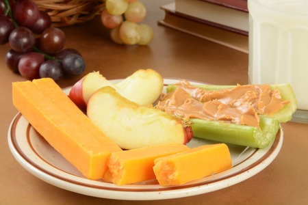 A plate of cheese, celery with peanut butter and apples after school Imagens - 33038372