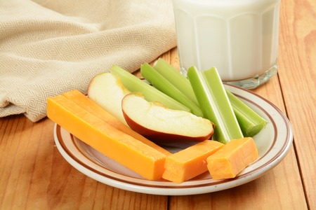 healthy snack: A healthy snack with celery sticks, apple slices and cheese Stock Photo