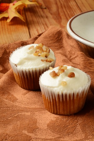 Gourmet carrot cupcakes with nuts and a cup of coffee photo