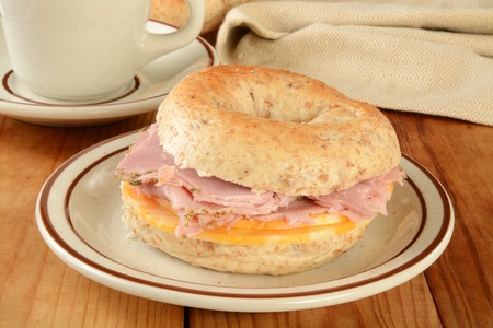 multi grain: A ham and cheese sandwich on a multi grain bagel