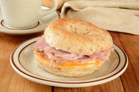 multi grain sandwich: A ham and cheese sandwich on a multi grain bagel