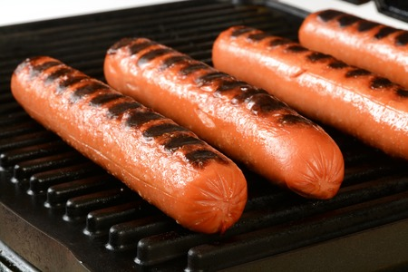 Hot dogs on an electric grill, shallow depth of field, focus near front