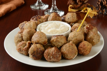 A serving platter of Swedish meatballs with cream sauce as an appetizer