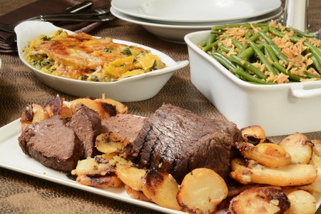 feast: Roast beef with fried garlic parmesan potatoes and green bean casserole