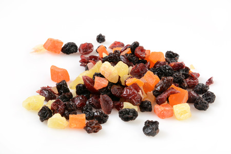 Dried cranberries, raisins, papaya, and mango on a whte background Banco de Imagens
