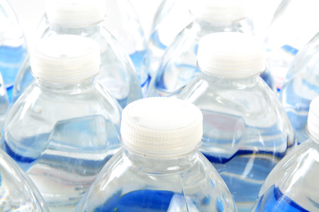 Closeup of the tops of rows of bottled water Banco de Imagens - 33760070