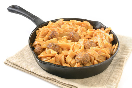 Swedish meatballs in a cast iron skillet on a white background Stock fotó