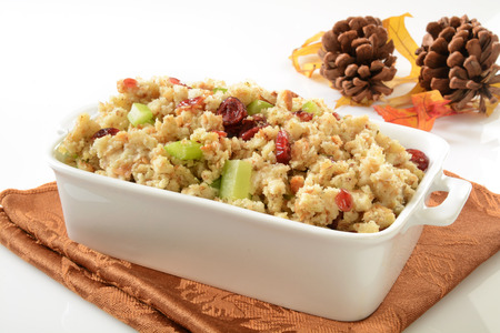 stuffing: Cranberry celery stuffing with turkey broth on a white table