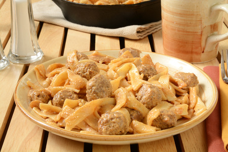 A plate of swedish meatballs with noodles and gravy Stock fotó
