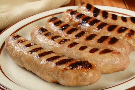 veal sausage: A plate of hot grilled bratwurst sausages