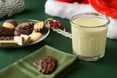 egg nog: Assorted gourmet Christmas cookies with a glass of egg nog