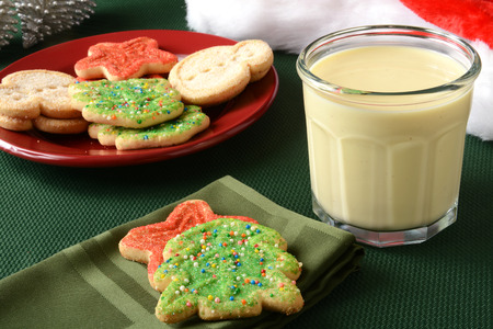 egg nog: Christmas cookies with a glass of egg nog Stock Photo