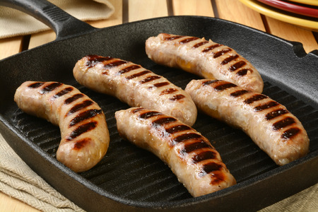 veal sausage: Grilled bratwurst sausage in a cast iron skillet Stock Photo