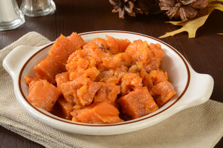 Sweet potatoes cooked in maple syrup with cranberries and pecans