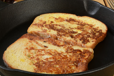 Golden brown french toast in a cast iron skillet