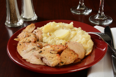 Succulent turkey with mashed potatoes and melted butter