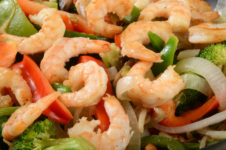 stir up: Close up shot of shrimp stir fry with vegetables