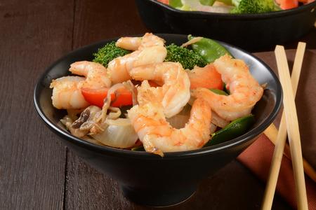 chop sticks: Shrimp stir fry and vegetables with chop sticks
