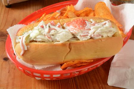 potato basket: A crab salad sandwich in a basket with potato chips Stock Photo