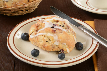 scone: A blueberry scone on a plate with fresh berries Stock Photo