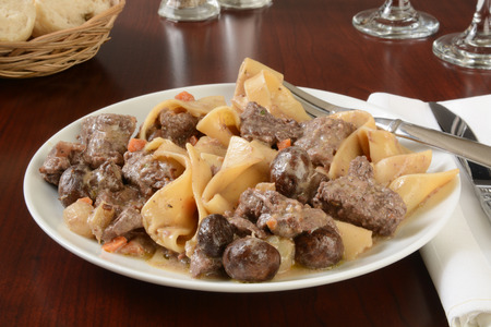beef stroganoff: Beef stroganoff with pearl onions and mushrooms on pappardelle pasta