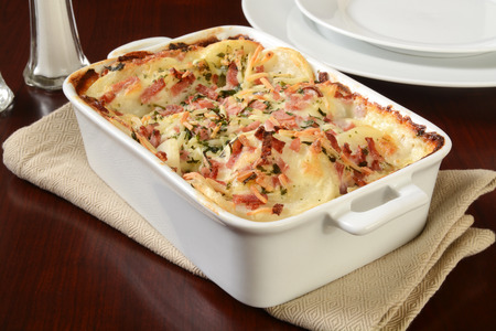 casserole dish: Scalloped potatoes in cheese sauce with ham in a casserole dish Stock Photo