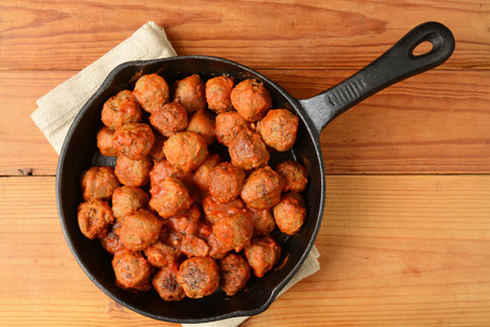 Italian meatballs in a cast iron skillet shot from a high angle view