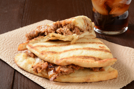 A chicken tikka sandwich on naan bread with a soft drink Stock Photo