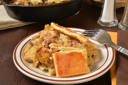 stuffing: Homemade turkey pot pie with cornbread stuffing and vegetables Stock Photo