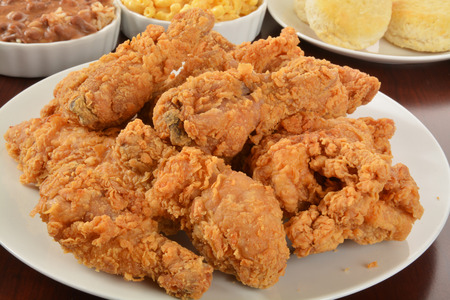 chicken: A plate of fried chicken with side dishes