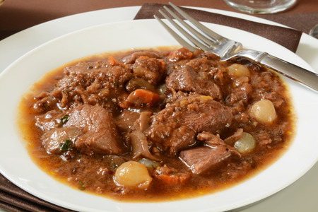 braised mushrooms: Slow cooked beef in burgundy wine sauce with pearl onions, mushrooms, carrots and spices