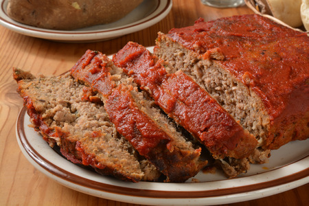 meatloaf: Meatloaf with tomato paste on a serving plate Stock Photo