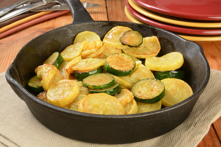 non stick: Sauteed summer and zucchini squash in a cast iron skillet Stock Photo