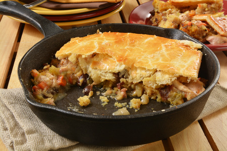 cornbread: Home made turkey pot pie with vegetables and cornbread stuffing in a cast iron skillet