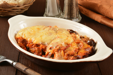A dish of eggplant parmesan with meat
