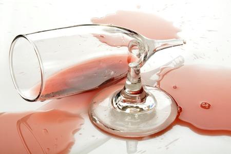 goblet: A broken wine goblet with burgundy wine