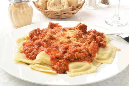 marinara: Closeup of a plate of beef ravioli with marinara sauce