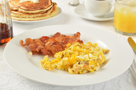 jacks: Bacon and scrambled eggs with pancakes and juice Stock Photo