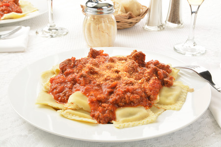 marinara: A plate of beef ravioli with a marinara and meat sauce Stock Photo