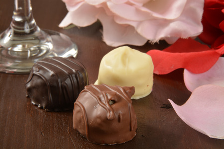 champagne truffles chocolate: Assorted gourmet chocolates on a romantic setting Stock Photo