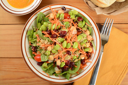 Healthy salad with chickpeas, cranberries, edamame, and more