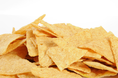 A mound of corn tortilla chips on a white background Stock Photo